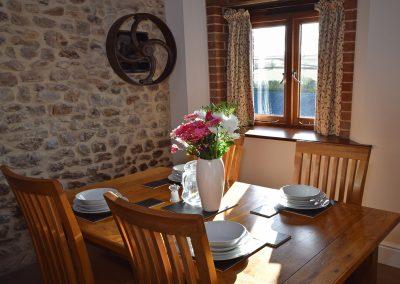 Apple-loft-dining-area-Farwood-Barton-Holiday-Cottages-Colyton-Devon