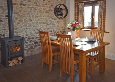 Apple-loft-dining-log-burner-Farwood-Barton-Holiday-Cottages-Colyton-Devon